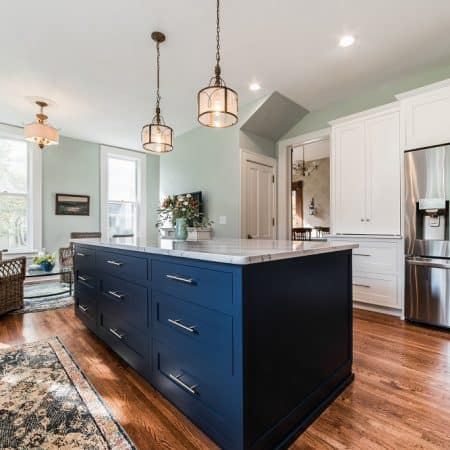 White kitchen remodel with navy blue island