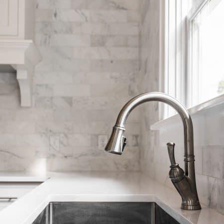 beautiful kitchen sink in white kitchen