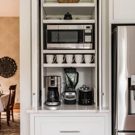 custom white cabinet in white kitchen
