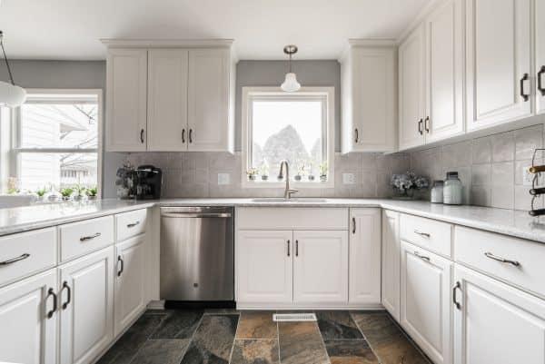 dekalb kitchen remodel stone floor white cabinets