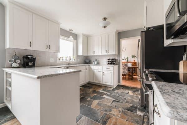 kitchen remodel stone floor white cabinets