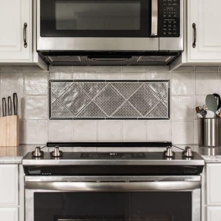 kitchen remodel stove white cabinets
